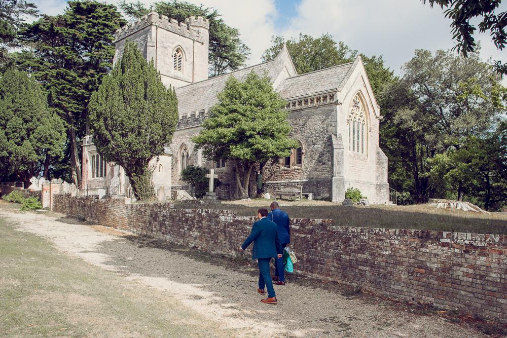 Groom walking up to the church on Brownsea island