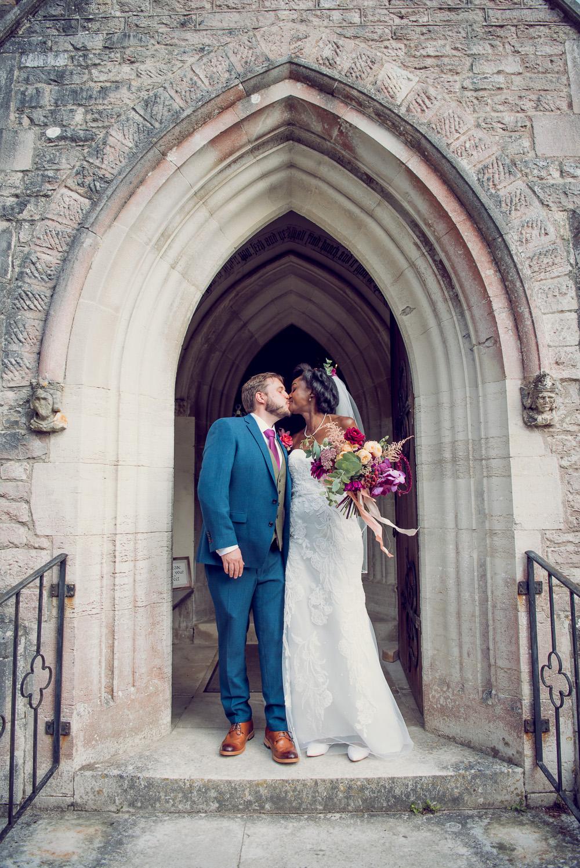 Brownsea island Church bride and groom on the church step
