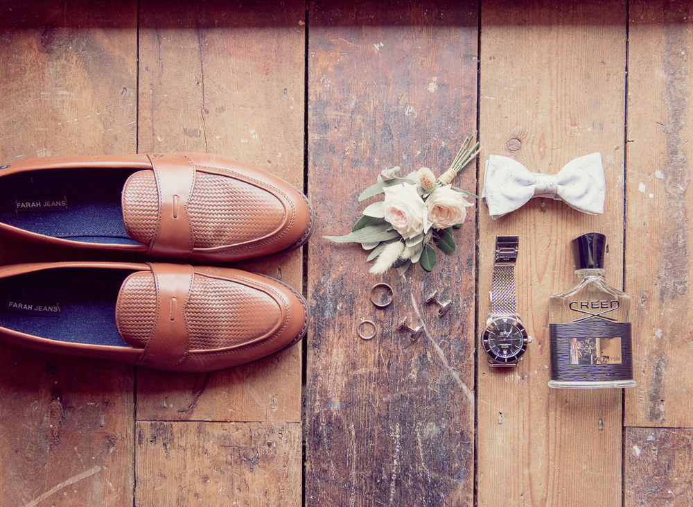 Groom Prep images shoes watch and flowers at St Giles House