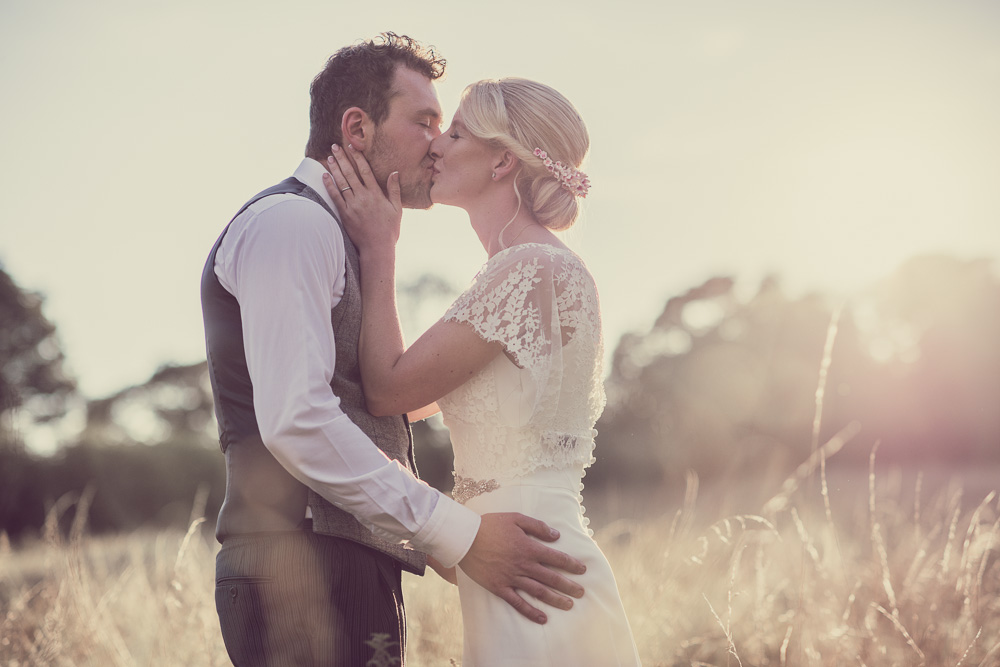 Beautiful and effortless Bride & Groom wedding photo at sunset