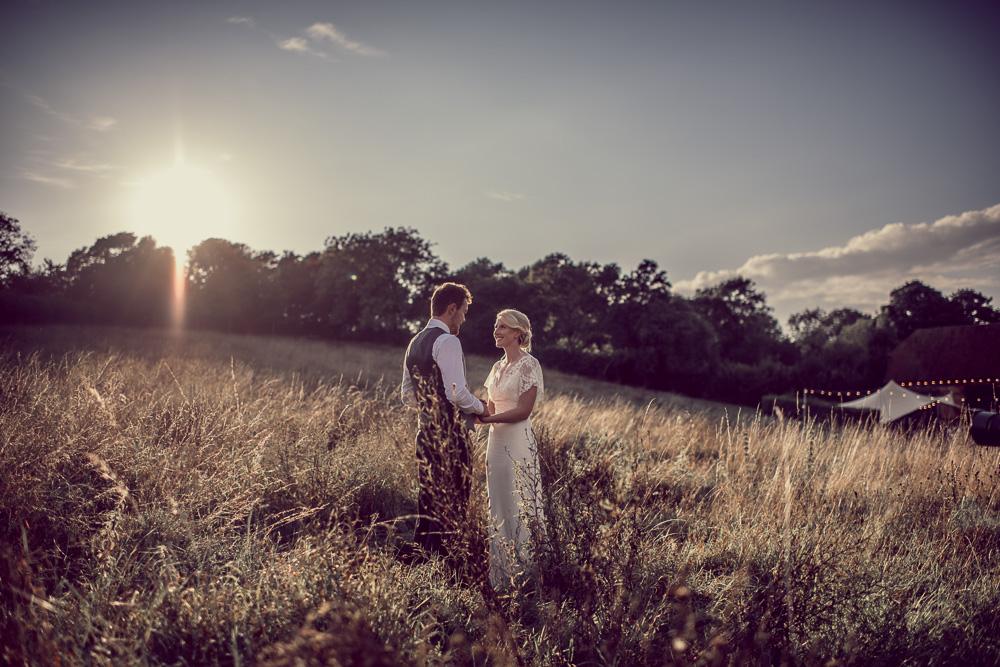 Barn Wedding Hampshire wedding photo in fields at sunset