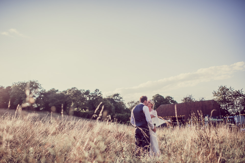 Barn wedding in Hampshire - Wedding photo in Fields with Barn