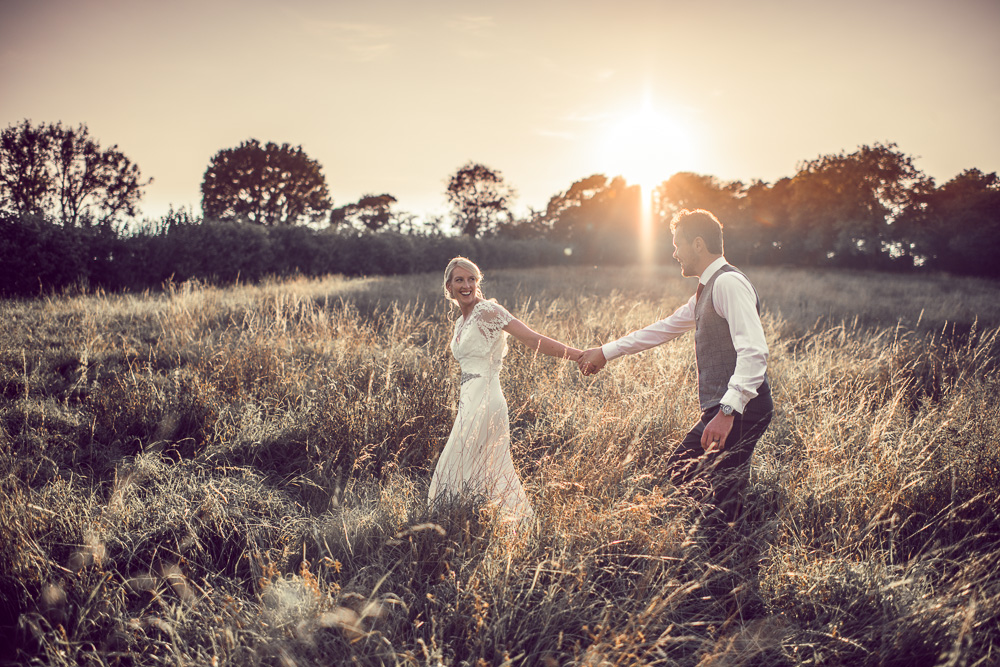 Wedding photo in fields at sunset